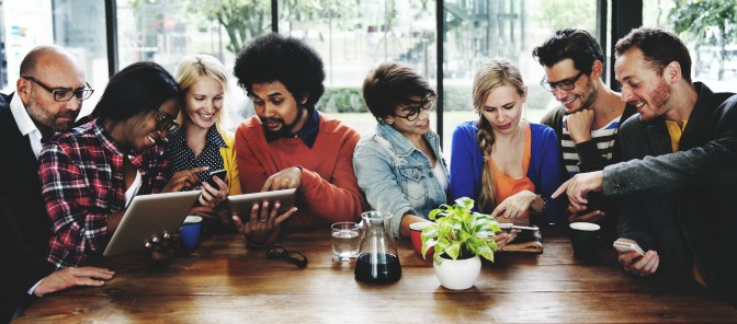 People sitting around a table planning a wedding.