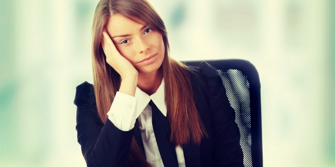 Frustrated event planner sitting at her desk