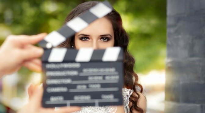 Woman being filmed about to start a new scene
