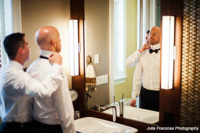Same-sex couple getting ready together before their wedding. Julia Franzosa Photography.