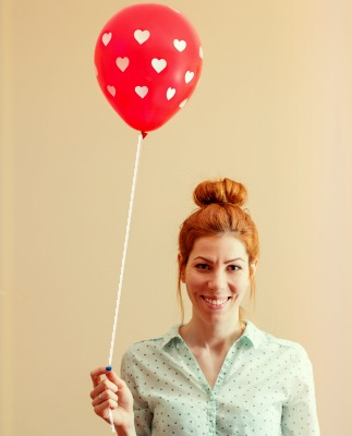 Woman holding a balloon