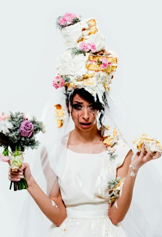 Unhappy bride with cake on her head