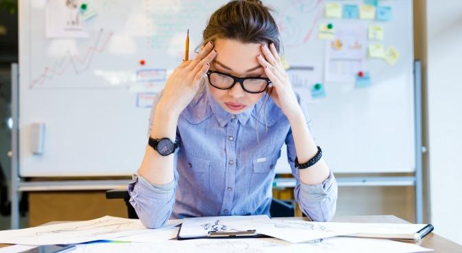 Frustrated event planner at her desk