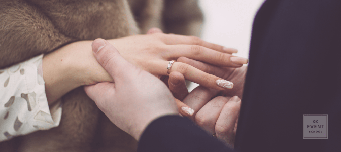 couple outdoors, man putting engagement ring on fiance's finger