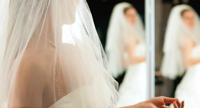 Bride trying on wedding gowns