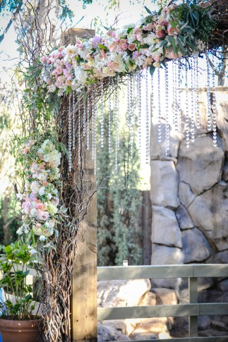 Floral wedding arch.   Planned by Regina Osgood, photography by Half Full Photography