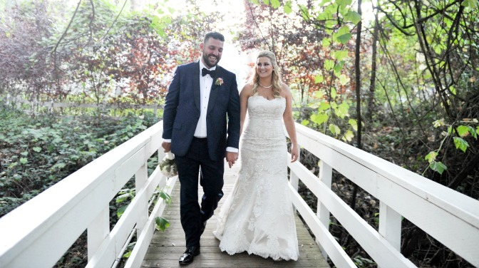 Bride and groom on bridge.  Planned by Regina Osgood, photography by Half Full Photography