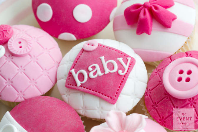 pink decorative cupcakes that say baby
