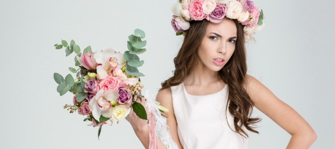 Why do brides throw their bouquets after the wedding ceremony?