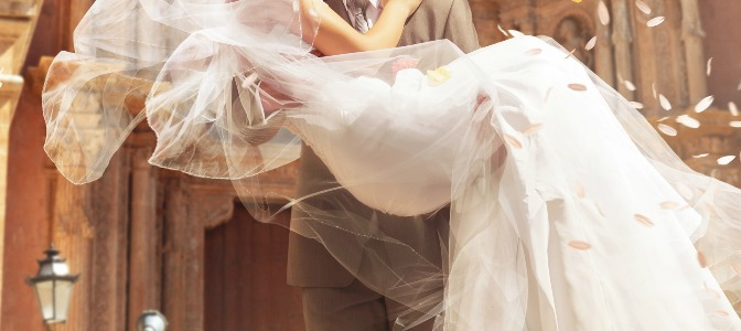 Why is it customary for the groom to carry the bride over the threshold?