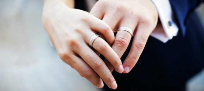 Why are engagement and wedding rings worn on the fourth finger of the left hand?