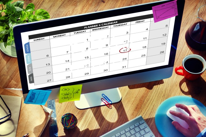 Mac with event planning technology apps for event planner