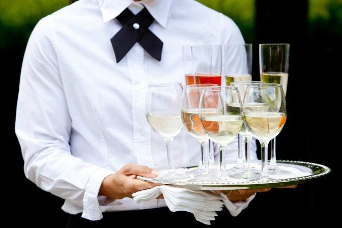Waiter with wine from open bar at wedding for wedding toast
