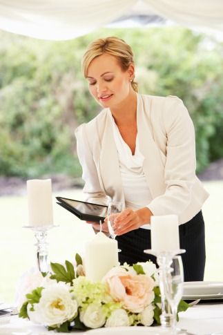 Wedding planner using a checklist and directing wedding guests