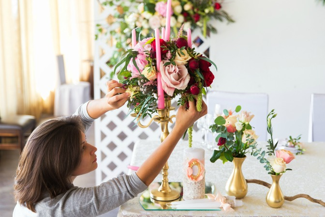 Event planner decorating venue for her event planning business ideas