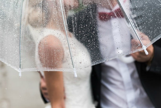 Destination wedding planning and rainy wedding photograph