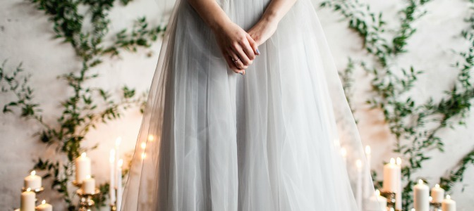 Bride with candlelight aisle and DIY vine background