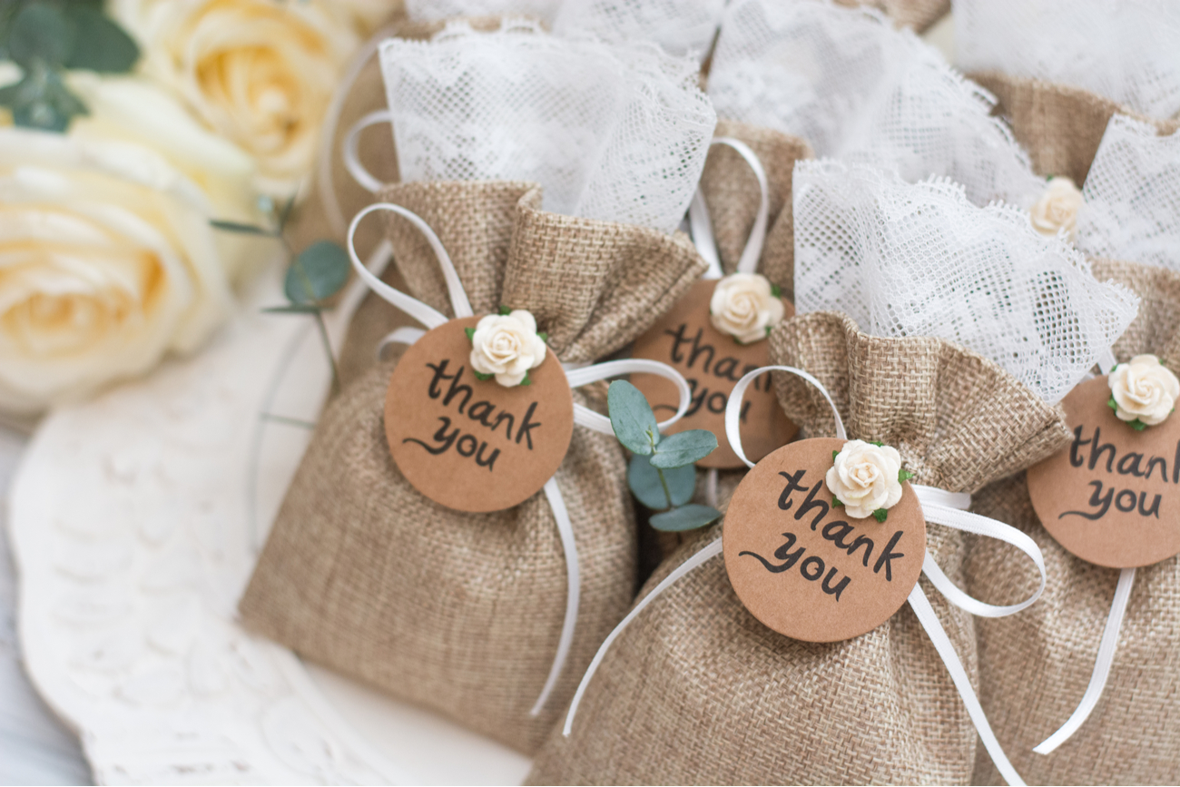 wedding favors - small cute bags with thank you note on front