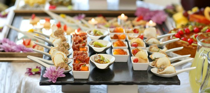 When is the general cut-off time for guest numbers when planning a catered event?