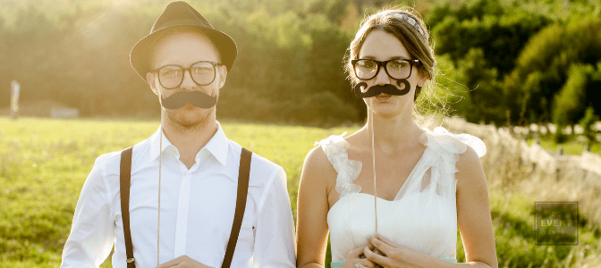 cute bride and groom wearing fake mustaches