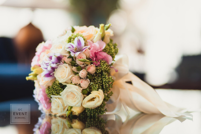 wedding bouquet that is tossed and left alone during wedding reception