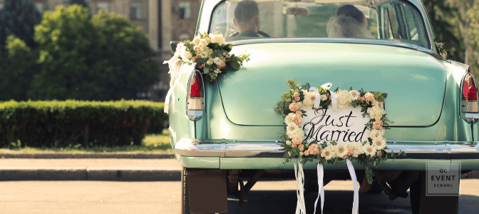 back of a green cadillac with 'just married' sign on back