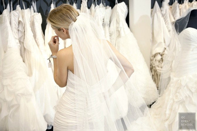 Helping bride choose wedding gown as an event planner