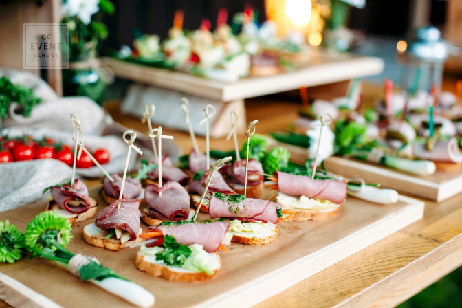 event planner coordinates catering services - hors d'oeuvres on table