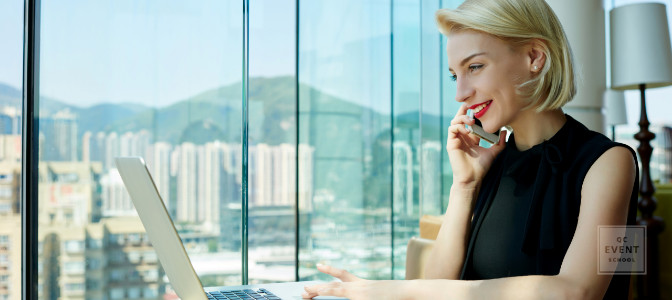 event planner on the phone working in a large city