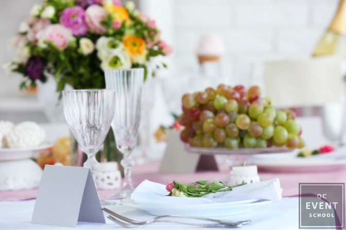 arrangement of food, flowers, and table setting for wedding