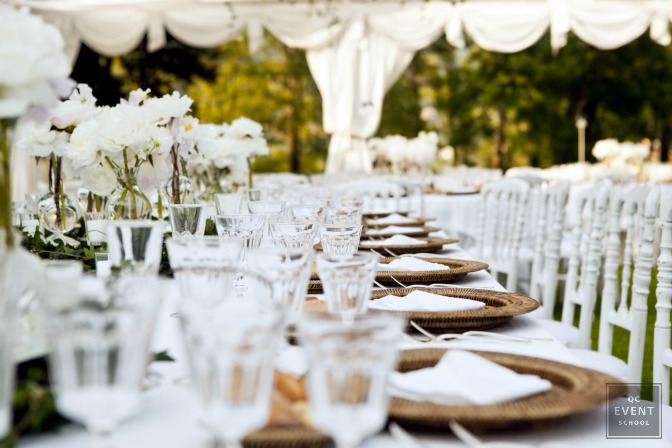 White themed reception designed by wedding planner
