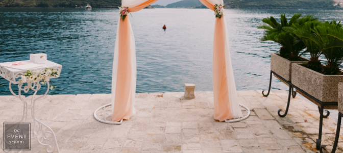 destination wedding with pink archway and ocean