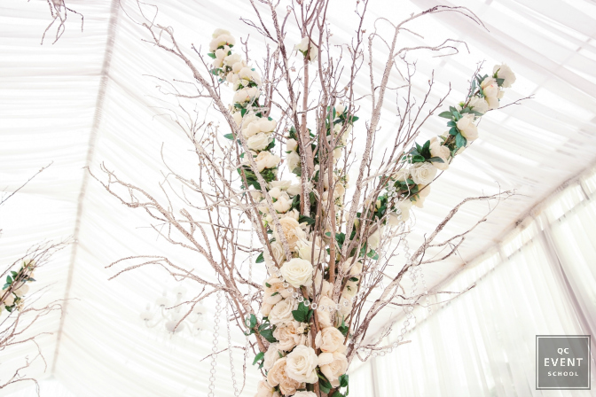 floral covered tree decor at a winter wedding