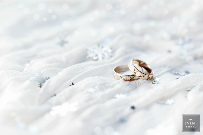 Winter wedding event with gold wedding bands.