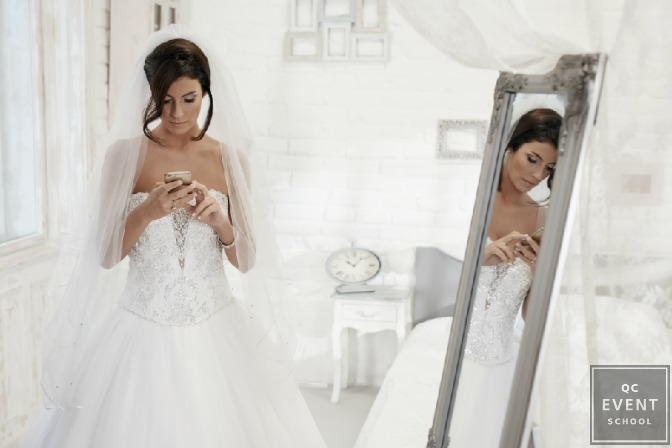bride looking at her cell phone