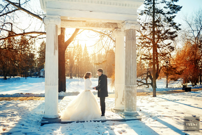 Outdoor event planned for a winter wedding. Couple featured under a white gazebo.