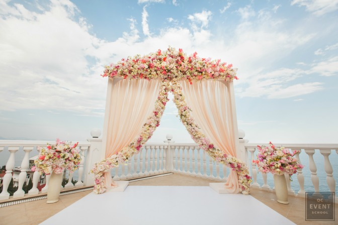 floral covered archway at destination wedding
