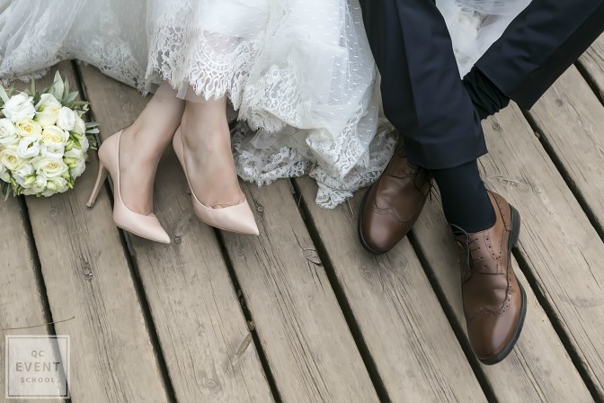 bride and groom sitting on boardwalk