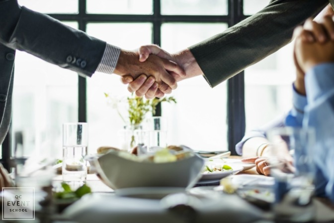 business persons shaking hands