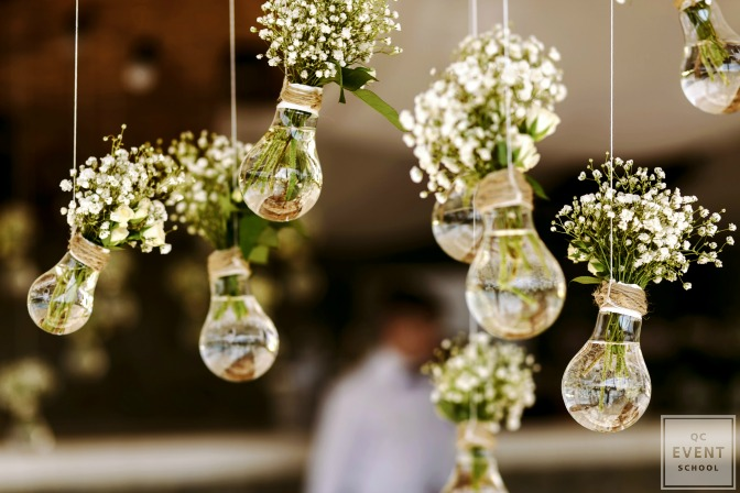 flowers in hanging light bulbs event decor
