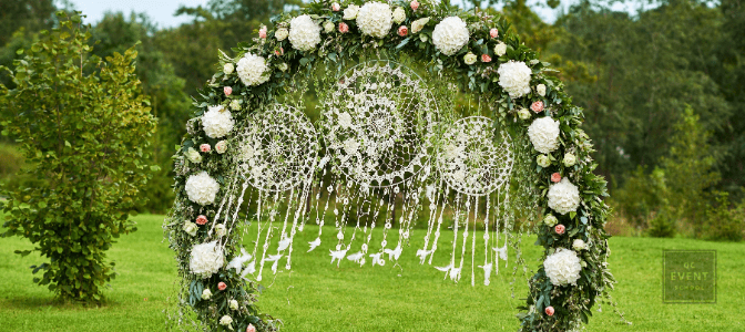 Wedding arch of flowers.Wedding ceremony.Festive Flower Arch.
