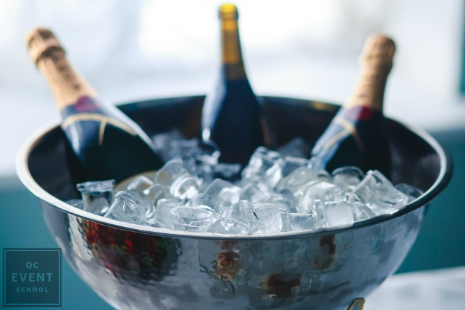champagne in ice bucket for wedding event