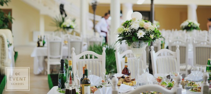 white and green wedding table with large centrepieces