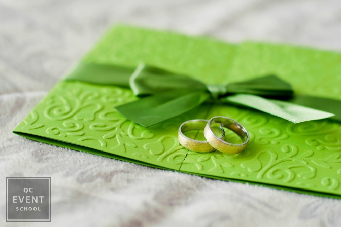 invitation and rings placed by event planner