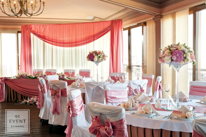 party planner classes pink wedding event hall with white chairs and flowers