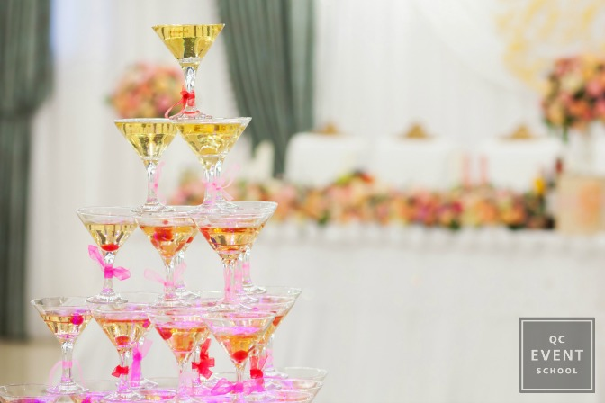 party planner classes tower of champagne glasses at event