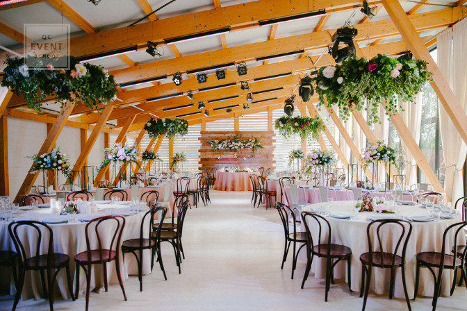 hanging potted plants at an event to create high low event decor