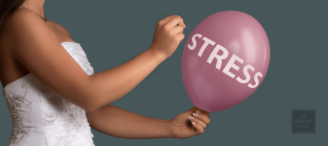 bride holding a pink balloon that says 'STRESS', and is about to pop it with a pin