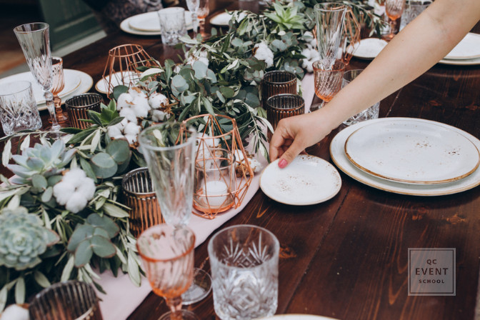 tablescape event and party planning professional decorating a table for dinner