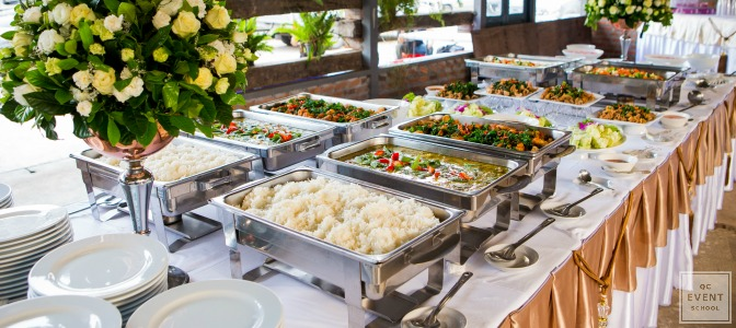 You know the guest list by heart and notice an unfamiliar face by the buffet table. Do you…